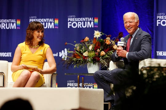 Democratic presidential candidate Joe Biden laughs after a question by Lyz Lenz, columnist for The Gazette, as he speaks at an LGBTQ Presidential Forum in the Sinclair Auditorium on the Coe College campus in Cedar Rapids, Iowa, Friday, Sept. 20, 2019.