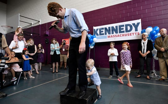 U.S. Rep. Joseph Kennedy III, D-Mass., reacts as his 1-year-old son, James, attempts to climb onto the podium as he announces his candidacy for the Senate on Saturday, Sept. 21, 2019, in Boston.