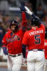 Braves outfielder Ronald Acuna Jr. celebrates after a two-run home run against the Giants.