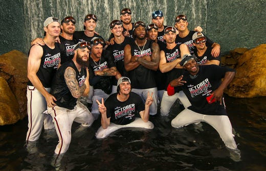 September 20: Braves players celebrate at the fountain behind the central field after winning their second consecutive title at NL East.