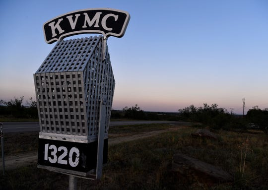 The radio station's signature oversized microphone stands outside KVMC/KAUM radio in Colorado City Wednesday.