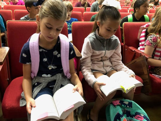 Hartleigh Dahlberg, left, and Sophie Ruscher, third-grade students at Eula Elementary, spend the morning Friday reading through their new dictionaries provided by Altrusa of Abilene.