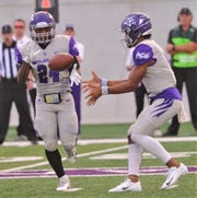 ACU quarterback Sema'J Davis, right, tosses a shovel pass to Tyrese White. White gained nine yards to the ACU 31 on the play in the Wildcats' Southland Conference game against McNeese on Saturday, Sept. 21, 2019, at Wildcat Stadium.