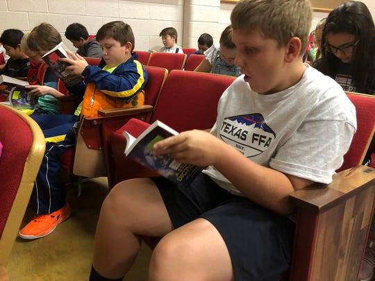 Jack Farmer is amazed by what he sees inside his dictionary Friday. Jack, a fifth-grade student at Eula Elementary, received the book of words from Altrusa of Abilene's AHEAD dictionary project, which received a grant of $2,700 to expand beyond Abilene students this year.