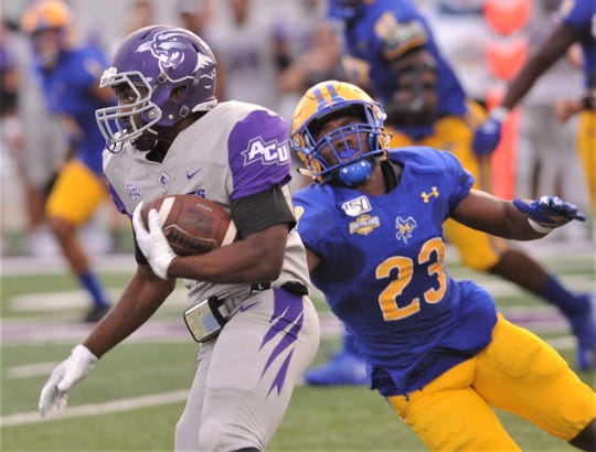 McNeese's Kordell Williams (23) stretches for ACU running back Tyrese White during the second quarter of their Southland Conference game Saturday, Sept. 21, 2019, at Wildcat Stadium.