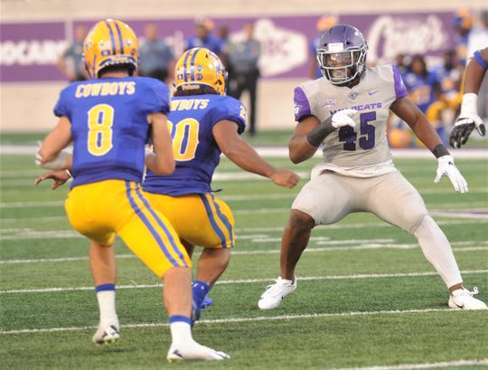 ACU linebacker Qua'Shawn Washington (45) eyes McNeese quarterback Cody Orgeron during their Southland Conference game Sept. 21 at Wildcat Stadium. The Abilene High grad is expected to return for the 2020 season, after suffering a season-ending injury last season.
