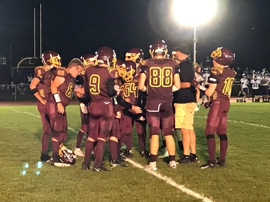 Whitney Point players gather during a timeout during Saturday's Section 4 Football Conference game against visiting Dryden. The Lions won, 40-34.
