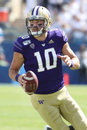 Washington quarterback Jacob Eason (10) looks to pass the ball during the first half of an NCAA college football game against BYU, Saturday, Sept. 21, 2019, in Provo, Utah.