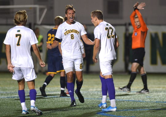Vermont's Arnar Steinn Hansson (8) reacts after Ivar Orn Arnason, right, converted a penalty kick during a college men's soccer game at Virtue Field on Saturday night, Sept. 21, 2019.