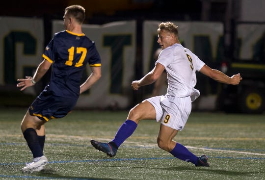 Vermont's Rasmus Tobinski fires in a goal against Merrimack during a college men's soccer game at Virtue Field on Saturday night, Sept. 21, 2019.