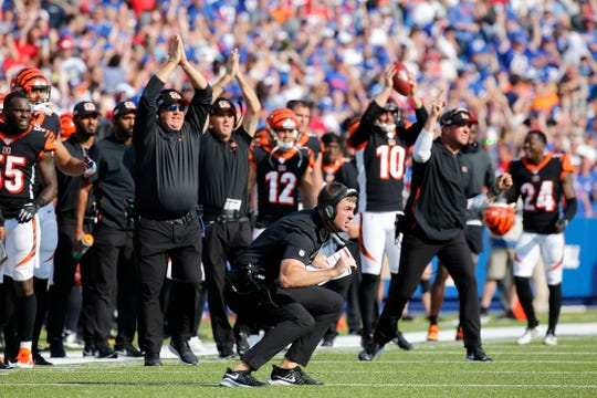 Cincinnati Bengals head coach Zac Taylor argues for a safety after Buffalo Bills cornerback Tre'Davious White (27) intercepted a pass intended for wide receiver Auden Tate (19) late in the fourth quarter of the NFL Week 3 game between the Buffalo Bills and the Cincinnati Bengals at New Era Stadium in Buffalo, N.Y., on Sunday, Sept. 22, 2019. The Bengals remain winless after a late interception ended a Bengals drive and sealed the win for Buffalo.