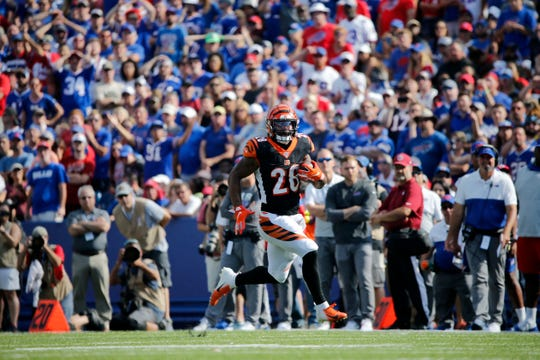 Cincinnati Bengals running back Joe Mixon (28) makes a deep run in the fourth quarter of the NFL Week 3 game between the Buffalo Bills and the Cincinnati Bengals at New Era Stadium in Buffalo, N.Y., on Sunday, Sept. 22, 2019. The Bengals remain winless after a late interception ended a Bengals drive and sealed the win for Buffalo.