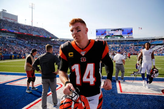 Cincinnati Bengals quarterback Andy Dalton (14) runs off the field after the fourth quarter of the NFL Week 3 game between the Buffalo Bills and the Cincinnati Bengals at New Era Stadium in Buffalo, N.Y., on Sunday, Sept. 22, 2019. The Bengals remain winless after a late interception ended a Bengals drive and sealed the win for Buffalo.