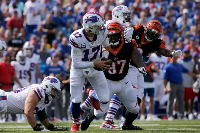 Buffalo Bills quarterback Josh Allen (17) runs from Cincinnati Bengals defensive tackle Geno Atkins (97) in the first quarter of the NFL Week 3 game between the Buffalo Bills and the Cincinnati Bengals at New Era Stadium in Buffalo, N.Y., on Sunday, Sept. 22, 2019. The Bills led 14-0 at halftime.