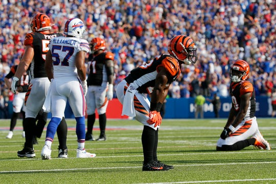 The Cincinnati Bengals offense reacts after a pass intended for wide receiver Auden Tate (19) is intercepted by Buffalo Bills cornerback Tre'Davious White (27) to seal the win for Buffalo in the fourth quarter of the NFL Week 3 game between the Buffalo Bills and the Cincinnati Bengals at New Era Stadium in Buffalo, N.Y., on Sunday, Sept. 22, 2019. The Bengals remain winless after a late interception ended a Bengals drive and sealed the win for Buffalo.