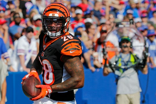 Cincinnati Bengals running back Joe Mixon (28) makes a touchdown reception in the fourth quarter of the NFL Week 3 game between the Buffalo Bills and the Cincinnati Bengals at New Era Stadium in Buffalo, N.Y., on Sunday, Sept. 22, 2019. The Bengals remain winless after a late interception ended a Bengals drive and sealed the win for Buffalo.