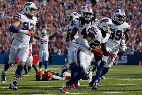 Buffalo Bills cornerback Tre'Davious White (27) runs off with the ball after intercepting a pass intended for Cincinnati Bengals wide receiver Auden Tate (19) to seal the win for Buffalo in the fourth quarter of the NFL Week 3 game between the Buffalo Bills and the Cincinnati Bengals at New Era Stadium in Buffalo, N.Y., on Sunday, Sept. 22, 2019. The Bengals remain winless after a late interception ended a Bengals drive and sealed the win for Buffalo.