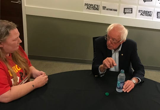 U.S. Sen. Bernie Sanders, of Vermont, meets with Fight for $15 activist Kelly Osborn on Saturday afternoon. Osborn, a McDonald's worker, had her hours cut shortly after appearing in an ad for Sanders, but says the two are unrelated.