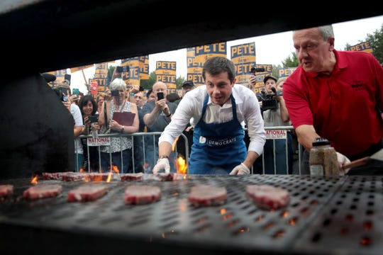 Democratic presidential candidate and South Bend, Indiana mayor Pete Buttigieg works the grill at the Polk County Democrats' Steak Fry on September 21, 2019 in Des Moines, Iowa. Seventeen of the 2020 Democratic presidential candidates and more than 12,000 of their supporters made an appearance at the event.