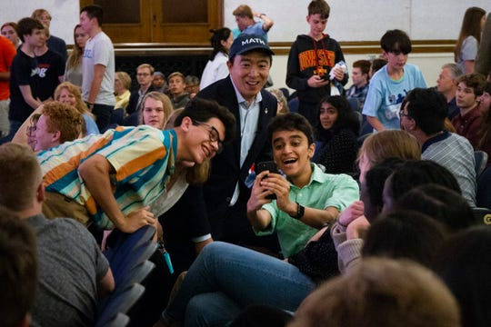 Andrew Yang takes a moment for selfies following his Youth forum speech session on Sept. 22, 2019 at Roosevelt High School in Des Moines.