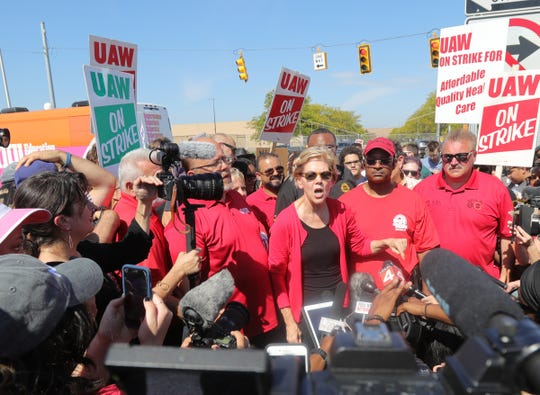 Democratic presidential candidate Elizabeth Warren joined UAW workers on the picket line in front of the Detroit Hamtramck Assembly plant Sunday, September 22, 2019 in Detroit, Mich.