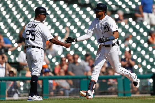 Tigers right fielder Victor Reyes celebrates with third base coach Dave Clark after hitting a solo home run during the fourth inning on Sunday, Sept. 22, 2019, at Comerica Park.