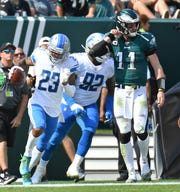 Lions cornerback Darius Slay celebrates his fumble return Sunday.