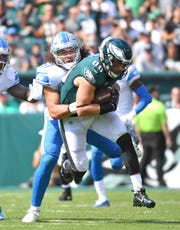 Zach Ertz is tackled by Jahlani Tavai during the second quarter.