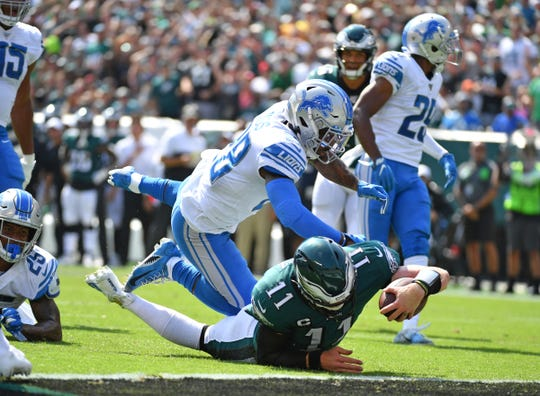 Eagles' Carson Wentz is stopped short of the goal line by Quandre Diggs on Sept. 22, 2019.