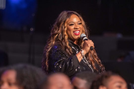 Kierra Sheard performs with the Detroit Youth Choir at the Motown 60 Gospel Concert at Triumph Church in Detroit on Saturday, Sept. 21, 2019.