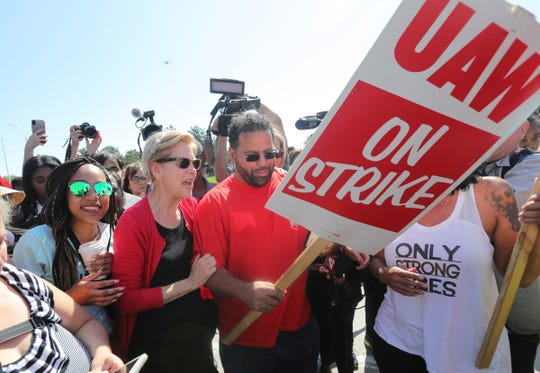 Democratic presidential candidate Elizabeth Warren joins UAW workers on the picket line in front of the Detroit Hamtramck Assembly plant Sunday.