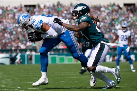 Lions tight end Logan Thomas makes a reception past Eagles cornerback Ronald Darby during the second quarter on Sunday, Sept. 22, 2019, in Philadelphia.
