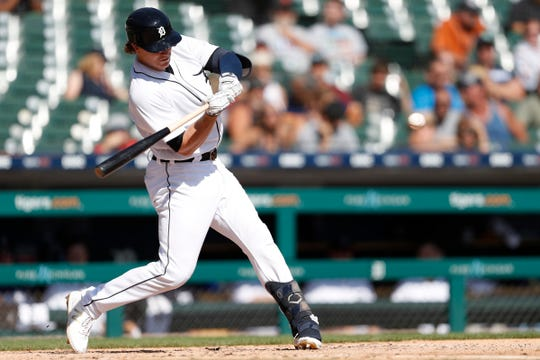 Tigers left fielder Brandon Dixon hits a single during the fourth inning on Sunday, Sept. 22, 2019, at Comerica Park.