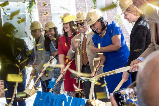 From left, Jim Vella, Elesha Bridgers, Governor Gretchen Whitmer, Berry Gordy Jr., Robin Terry and U.S. Sen. Debbie Stabenow react as confetti falls during the groundbreaking ceremony of the new Hitsville Next center in Detroit, Mich., Sunday, Sept. 22, 2019.