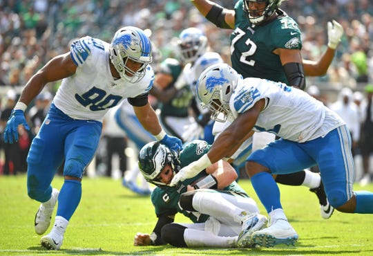 Eagles quarterback Carson Wentz is sacked by Lions defensive end Trey Flowers and linebacker Devon Kennard during the second quarter Sunday.