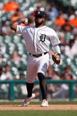 Tigers third baseman Dawel Lugo makes a throw to first base for an out during the fifth inning on Sunday, Sept. 22, 2019, at Comerica Park.