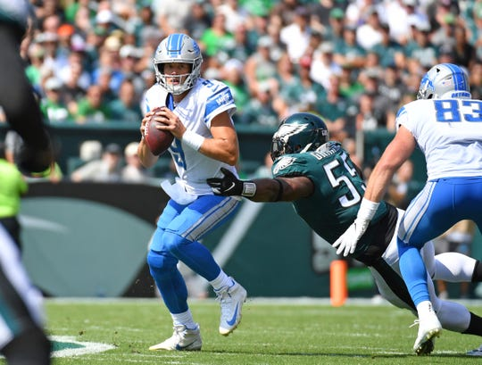 Lions quarterback Matthew Stafford eludes tackle by Eagles defensive end Brandon Graham during the first quarter on Sunday, Sept. 22, 2019, in Philadelphia.