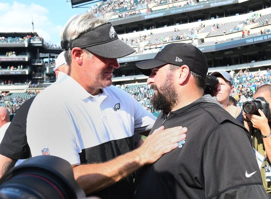 Eagles head coach Doug Peterson and Lions head coach Matt Patricia meet on the field after the 27-24 Detroit victory.