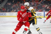 Penguins center Zach Aston-Reese (46) defends against Red Wings center Dylan Larkin (71) during the first period on Sunday.
