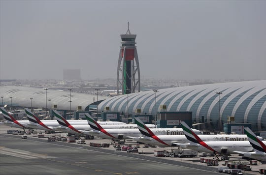 Emirates planes are parked at the Dubai International Airport in Dubai, United Arab Emirates.