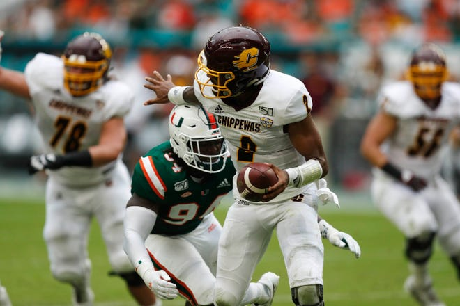 Miami defensive lineman Trevon Hill sacks Central Michigan quarterback David Moore during the first half.