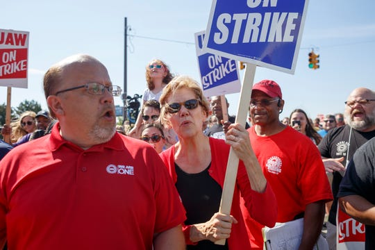 Sen. Elizabeth Warren walks alongside GM UAW members and supporters on the picket line at the Detroit-Hamtramck assembly plant.