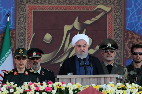 President Hassan Rouhani speaks at a military parade marking 39th anniversary of outset of Iran-Iraq war, in front of the shrine of the late revolutionary founder Ayatollah Khomeini, just outside Tehran, Iran on  Sunday.
