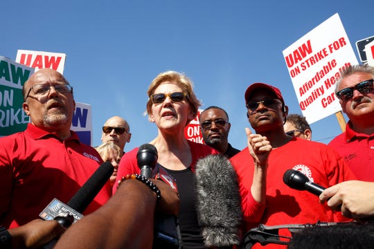 Senator Elizabeth Warren talks with members of the press after walking with GM UAW members and supporters on the picket line at the Detroit-Hamtramck assembly plant on day seven of the labor dispute strike on Sunday, Sept. 22, 2019 in Hamtramck.