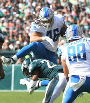 Lions' Nick Bawden hurdled Eagles' Rodney McLeod during the third quarter in Sunday's win.