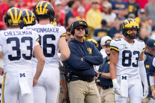 Michigan coach Jim Harbaugh watches as his players come off the field in the fourth quarter.