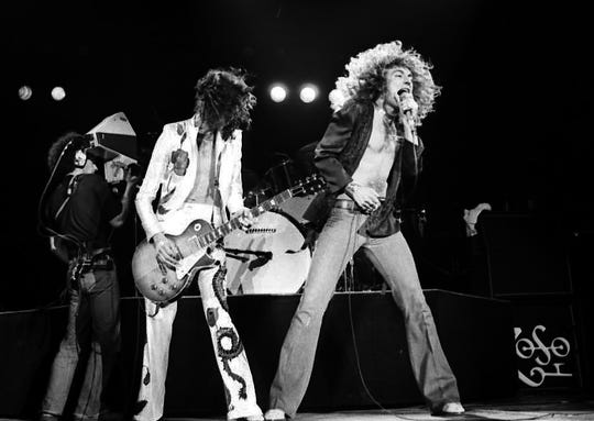 Guitarist Jimmy Page and singer Robert Plant of Led Zeppelin performs for a crowd of 80,000 fans at the Pontiac Silverdom on April 30, 1977.
