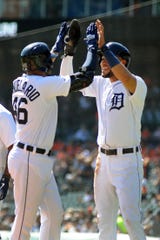 The Detroit Tigers' Jeimer Candelario, left, is congratulated by Victor Reyes after hitting a two-run home run against the Chicago White Sox in the first inning.