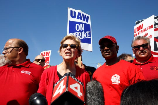 Sen. Elizabeth Warren talks with members of the press after walking with GM UAW members and supporters on the picket line at the Detroit-Hamtramck assembly plant on Sunday.