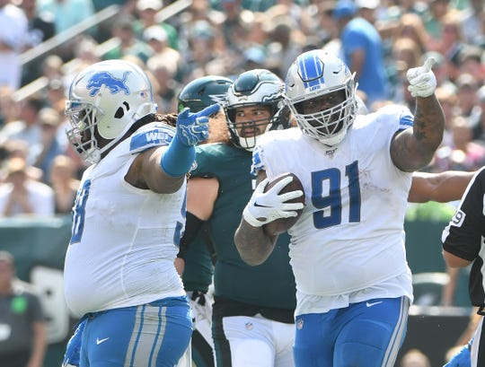 A'Shawn Robinson reacts after digging out a fumble in the second quarter.